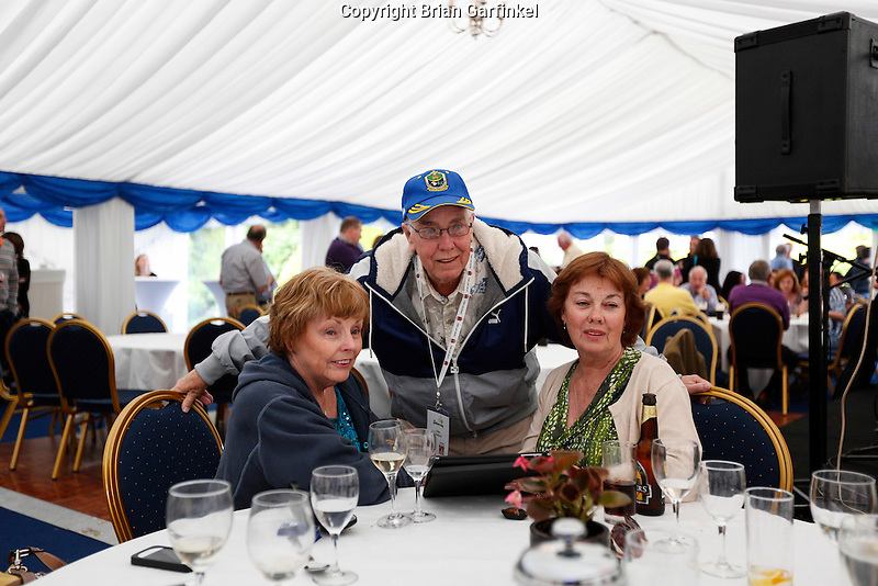 John with his sisters Jackie and Terry in the tent during the Caulfield family reunion at the Caulfield home in Granlahan, County Roscommon, Ireland on Tuesday, June 25th 2013. (Photo by Brian Garfinkel)