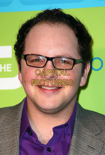 AUSTIN BASIS .AT the 2010 The CW Network UpFront at Madison Square Garden on May 20, 2010 in New York City,  New York, NY, USA, 20th May 2010..portrait headshot purple shirt grey gray jacket glasses .CAP/ADM/PZ.©Paul Zimmerman/AdMedia/Capital Pictures.
