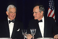 Washington DC, USA,  May 1992<br /> President George H.W. Bush. in Black tie at the White House Correspondents dinner. Seated next to him is Speaker of the House Thomas Foley. Credit: Mark Reinstein/MediaPunch