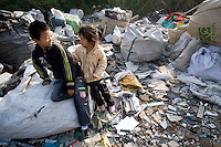 Chinese children grow up in a junk yard where electronic trash from the United States and other places is processed by migrant workers. The children do not attend school.