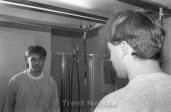 Ted Hansen in downstairs bathroom at Santa Teresa. Note hanging film, drying.<br />