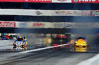 Feb. 27, 2011; Pomona, CA, USA; NHRA funny car driver Jim Head (left) defeats Bob Bode during the Winternationals at Auto Club Raceway at Pomona. Mandatory Credit: Mark J. Rebilas-