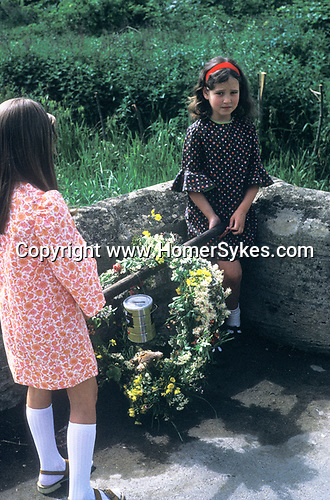 Bampton Oxfordshire young girls with May Day garlands of flowers.