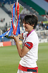 Olympique Lyonnais' Saki Kumagai celebrates the victory in the UEFA Women's Champions League 2015/2016 Final match.May 26,2016. (ALTERPHOTOS/Acero)