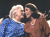 Barbara Bush, wife of United States Vice President George H.W. Bush, the Republican nominee for President of the United States, left, and Marilyn Quayle, wife of U.S. Senator Dan Quayle (Republican of Indiana), the Republican nominee for Vice President of the United States, right, share a conversation in the Vice President's box as the roll-call of the states continues during the 1988 Republican Convention in New Orleans, Louisiana on August 17, 1988.<br /> Credit: Howard L. Sachs / CNP