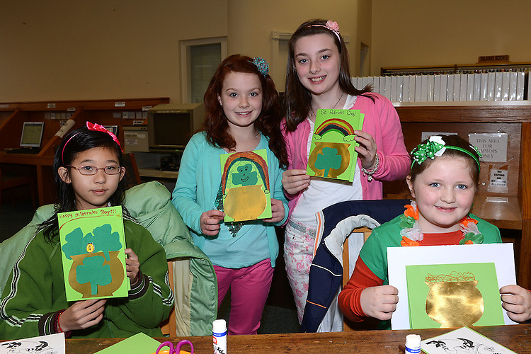 Jyte Yu, Rachel and Olivia Smith and Joy Mooney pictured at the St Patrick's day art and craft session in the library. Photo:Colin Bell/pressphotos.ie