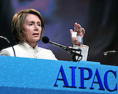 Washington, D.C. - June 4, 2008 -- The Speaker of the United States House of Representatives Nancy Pelosi (Democrat of California) holds up replica dog tags of three kidnapped Israeli soldiers -- Ehud Goldwasser, Eldad Regev and Gilad Shalit as she speaks at the American Israel Public Affairs Committee (AIPAC) 2008 Policy Conference in Washington, D.C. on June 4, 2008.  The dogtags were commissioned by United Jewish Communities (UJC) in the immediate aftermath of the kidnapping of the three soldiers, in a campaign that resulted in thousands of the dogtags being distributed to lawmakers and concerned individuals around the world to show sympathy for the soldiers and their families, and to appeal to anyone who might be able to help free the soldiers..Credit: Ron Sachs / CNP