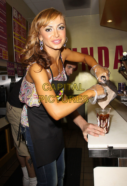 KARINA SMIRNOFF.Karina Smirnoff and Aaron Carter Visits 'Millions of Milkshakes' for Their Own Shake Mix held At Millions of Milkshakes, West Hollywood, California, USA..September 23rd, 2009.half length pink white pattern top apron hands plastic gloves pouring drink beverage blender .CAP/ADM/KB.©Kevan Brooks/AdMedia/Capital Pictures.