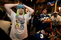 Adam Faravaag, left, shows his displeasure after the Steelers scored a touchdown while watching the Super Bowl at F.X.McRory's next to the Qwest Field Seattle Seahawk's, where fans cheers on their team showing some signs of disappointment and some signs of jubilation Sunday, Feb. 5 , 2006, in Seattle. (Kevin P. Casey/Bloomberg News)