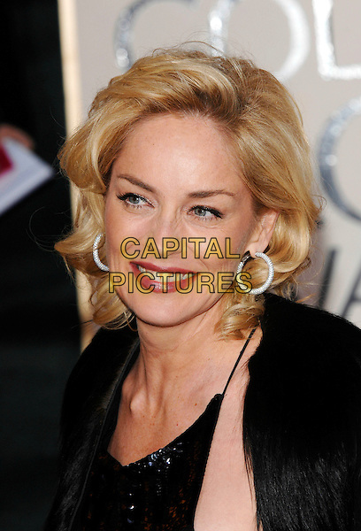 SHARON STONE.Red Carpet Arrivals - 64th Annual Golden Globe Awards, Beverly Hills HIlton, Beverly Hills, California, USA. .January 15th 2007.globes headshot portrait diamond hoop earrings .CAP/PL.©Phil Loftus/Capital Pictures