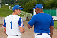 21 June 2011: Team Manager of France Fabien Proust talks to Carlos Jiminian during UCLA Alumni 5-3 win over France, at the 2011 Prague Baseball Week, in Prague, Czech Republic.