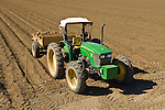 2006 John Deere 5525 Hi-Crop tractor with trailer of boulders (rocks) in field