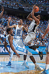 Keyshawn Woods (1) of the Wake Forest Demon Deacons makes contact with Kenny Williams (24) of the North Carolina Tar Heels during first half action at the Dean Smith Center on December 30, 2017 in Chapel Hill, North Carolina.  The Tar Heels defeated the Demon Deacons 73-69.  (Brian Westerholt/Sports On Film)