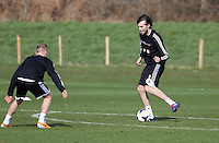 Pictured: Michu (R). Saturday 08 March 2014<br /> Re: Swansea City FC training at the Fairwood Training ground in the outskirts of Swansea, south Wales.