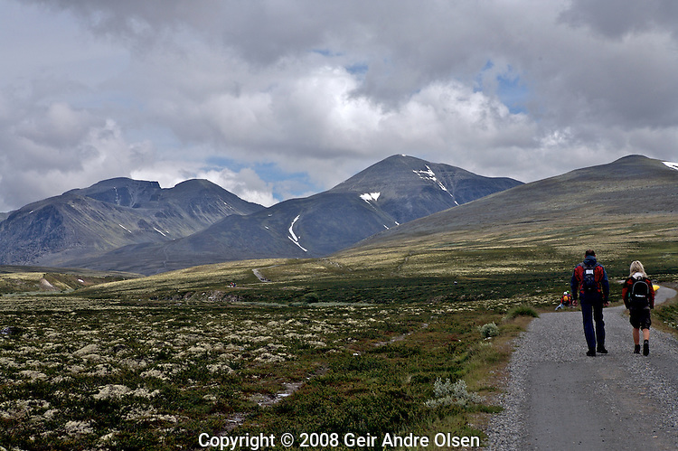 Walking towards Storronden and Rondeslottet at Rondane National Park, Norway