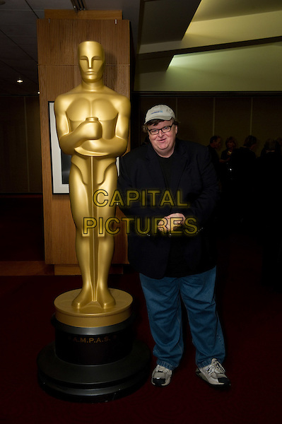 "Oscar-winner and Host Michael Moore prior to the Academy of Motion Picture Arts and Sciences' ""DOCS!"" event on Wednesday, February 22, 2012 at the Samuel Goldwyn Theater in Beverly Hills. The 84th Academy Awards® will be presented on Sunday, February 26, 2012, at the Hollywood & Highland Center®, and televised live by the ABC Television Network..* Editorial Use Only*.oscars full length black suit blue jacket trousers glasses hat.CAP/A.M.P.A.S./NFS.©A.M.P.A.S. Supplied by Capital Pictures. Oscars"