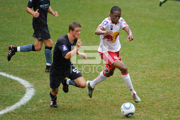 Macoumba Kandji (10) of the New York Red Bulls and Andrew Tutte (52) of Manchester City F. C. go for the ball. The New York Red Bulls defeated Manchester City F. C.2-1 during a Barclays New York Challenge match at Red Bull Arena in Harrison, NJ, on July 25, 2010.