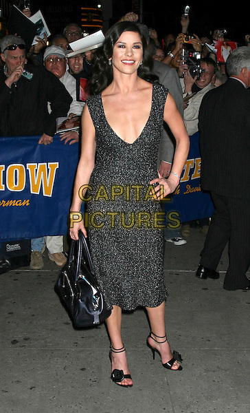 "CATHERINE ZETA-JONES.Stops by ""The Late Show With David Letterman"", Ed Sullivan Theatre, New York City..October 18th, 2005 .Ref: IW.full length black bag dress hand on hip plunging neckline.www.capitalpictures.com.sales@capitalpictures.com.©Capital Pictures"