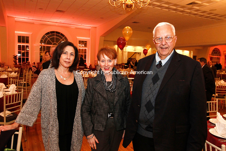 Southington, CT- 03 November 2014-110314CM11-  Social moments--- From left Patricia Clemente, Beverly Bucari and Richard Shaker, board members with the Boys and Girls Club of Greater Waterbury, during the 20th Annual Sacred Heart High School Awards Dinner at The Aqua Turf in Southington on Monday.  Christopher Massa Republican-American