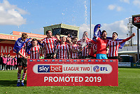 Lincoln City players celebrate after securing promotion from Sky Bet League Two<br /> <br /> Photographer Chris Vaughan/CameraSport<br /> <br /> The EFL Sky Bet League Two - Lincoln City v Cheltenham Town - Saturday 13th April 2019 - Sincil Bank - Lincoln<br /> <br /> World Copyright © 2019 CameraSport. All rights reserved. 43 Linden Ave. Countesthorpe. Leicester. England. LE8 5PG - Tel: +44 (0) 116 277 4147 - admin@camerasport.com - www.camerasport.com