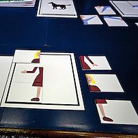 Produzione di pannelli di resina nel laboratorio dell'Istituto dei Ciechi a Milano, seguendo i criteri dell'alfabeto Braille. Con questi pannelli i ciechi possono leggere, e conoscere i monumenti attraverso il tatto..Puzzle con figura in rilievo, che i bambini devono comporre dopo aver toccato la figura intera. Alcuni particolari sono colorati con forti contrasti, per le persone  parzialmente cieche che percepiscono qualche ombra confusa. ..Production of resin panels in the laboratory of the Institute of the Blind people to Milan, following the criteria of the Braille alphabet. With these panels the blind people can read, and know monuments through the tact..In the photo: Puzzle with figure in relief, that children need to settle after handling the whole figure. Some details are colored with strong contrasts, for partially blind people who receive some shade confused.