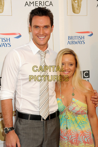 OWAIN YEOMAN & LUCY DAVIS .8th Annual BAFTA LA TV Tea Party held at the Hyatt Regency Century Plaza Hotel,  Century City, California, USA, 28th August 2010..half length married couple husband wife green yellow dress halterneck smiling white shirt tie arm around .CAP/ADM/BP.©Byron Purvis/AdMedia/Capital Pictures.