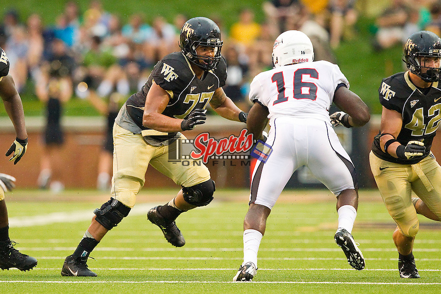 Devin Bolling (77) of the Wake Forest Demon Deacons looks to block Demetrius Ward (16) of the Liberty Flames at BB&T Field on September 1, 2012 in Winston-Salem, North Carolina.  The Demon Deacons defeated the Flames 20-17.  (Brian Westerholt/Sports On Film)