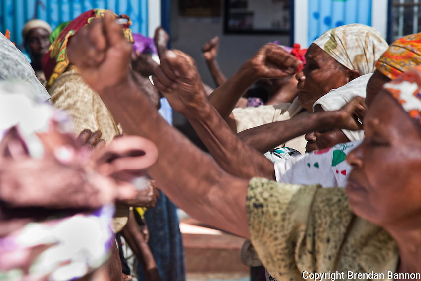"Grandmothers and ""Gender Defenders"" practice defensive blows in a class in Nairobi's Korogocho slum which is suffering a surge in violence against women."