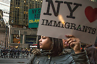 NEW YORK,NY APRIL 14: A woman holds a sign pro immigrants during the anti-Tump protest across the Hyatt Hotel in midtown Manhattan on April 14,2016 in New York City . Photo by VIEWpress/Maite H. Mateo