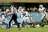 CHAPEL HILL, NC - NOVEMBER 02: Dominique Ross #3 of the University of North Carolina sacks Bryce Perkins #3 of the University of Virginia during a game between University of Virginia and University of North Carolina at Kenan Memorial Stadium on November 02, 2019 in Chapel Hill, North Carolina.