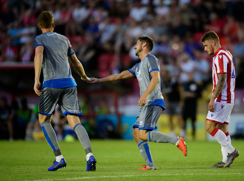 Lincoln City's Tom Pett, right, celebrates scoring his side's first goal with team-mate Cian Bolger<br /> <br /> Photographer Chris Vaughan/CameraSport<br /> <br /> Football Pre-Season Friendly - Lincoln City v Stoke City - Wednesday July 24th 2019 - Sincil Bank - Lincoln<br /> <br /> World Copyright © 2019 CameraSport. All rights reserved. 43 Linden Ave. Countesthorpe. Leicester. England. LE8 5PG - Tel: +44 (0) 116 277 4147 - admin@camerasport.com - www.camerasport.com