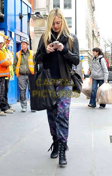 FEARNE COTTON.Leaving BBC Radio 1 this afternoon, London, England..March 10th, 2010.full length black boots bag purse jacket purple pink pattern trousers text texting mobile phone iphone walking .CAP/DYL.©Dylan/Capital Pictures.