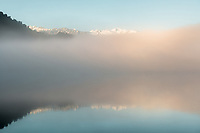 Sunrise over Lake Mapourika with winter fog, Westland Tai Poutini National Park, West Coast, UNESCO World Heritage Area, New Zealand, NZ