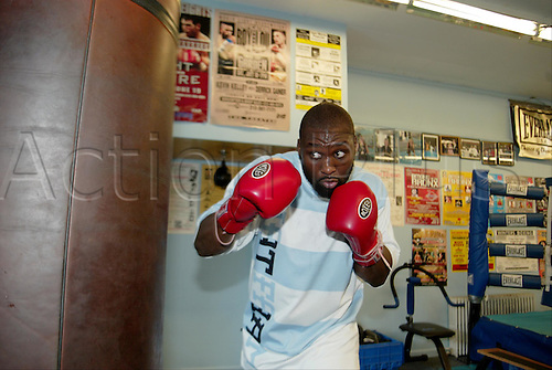 8 Jul 2004:  Danny Williams, from London, England, hits the heavy bag at his training camp in Long Island, NY. Williams is preparing for his bout with Mike Tyson in Louisville, KY..Mandatory Credit:  Teddy Blackburn/Icon SMI