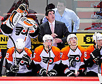 7 December 2009: Philadephia Flyers' newly appointed Head Coach Peter Laviolette looks up at the scoreboard during a game against the Montreal Canadiens at the Bell Centre in Montreal, Quebec, Canada. The Canadiens defeated the Flyers 3-1. Mandatory Credit: Ed Wolfstein Photo