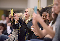 NWA Democrat-Gazette/BEN GOFF @NWABENGOFF<br /> Family members take pictures on Friday Jan. 15, 2016 during Bentonville High's colors day ceremony at halftime in the boys basketball game against Springdale Har-Ber in Bentonville's Tiger Arena.