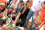 Israeli Yonna Taamam, wife of Tiran Taamam, grieves over hisGRA during his funeral and that of his brother Aryeh, in Akko, northern Israel, Sunday, Aug. 6, 2006. The two Taamam brothers were killed Thursday in a Hezbollah rocket attack JINI/ANCHO GOSH/EPA