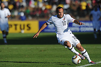 American midfielder Landon Donovan makes an exceptional effort to save a ball from going over touchline during the final U.S. tune-up prior to the opening of the 2010 FIFA World Cup. The U.S. won the match over Australia, 3-1, played June 5th, in Ruimsig Stadium,  at Roodepoort, South Africa.