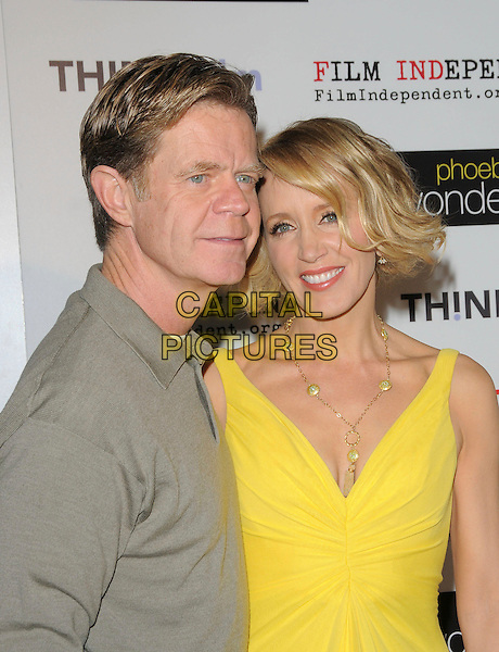 "WILLIAM H. MACY & FELICITY HUFFMAN .Screening of ""Phoebe in Wonderland"" held at The WGA in Beverly Hills, California, USA, .March 1st 2009.                                                                     .half length bright yellow dress beige husband wife grey gray shirt top .CAP/DVS.©RockinExposures/Capital Pictures"