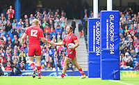 Wales's Jevon Groves, left, congratulates team-mate William Harries on scoring the first try<br /> <br /> Australia Vs Wales - Men's quarter-final<br /> <br /> Photographer Chris Vaughan/CameraSport<br /> <br /> 20th Commonwealth Games - Day 4 - Sunday 27th July 2014 - Rugby Sevens - Ibrox Stadium - Glasgow - UK<br /> <br /> © CameraSport - 43 Linden Ave. Countesthorpe. Leicester. England. LE8 5PG - Tel: +44 (0) 116 277 4147 - admin@camerasport.com - www.camerasport.com