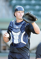 Catcher Wes Wilson (5) of the Charleston RiverDogs prior to a game against the Greenville Drive on Opening Day, Friday, April 5, 2013, at Fluor Field at the West End in Greenville, South Carolina. (Tom Priddy/Four Seam Images)