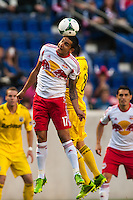 Tim Cahill (17) of the New York Red Bulls goes up for a header with Matías Sanchez (8) of the Columbus Crew. The New York Red Bulls and the Columbus Crew played to a 2-2 tie during a Major League Soccer (MLS) match at Red Bull Arena in Harrison, NJ, on May 26, 2013.