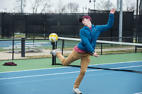 "Alex Ezell, a student at Bentonville West High School, returns the ball Tuesday, March 17, 2020, while playing ""Phishball"" with friends at the Memorial Park tennis courts in Bentonville. Phishball is a game that combines elements of volleyball, tennis and soccer.The students from Bentonville had free time after completing their online assignments for the day. All of their schools have moved to online instruction this week to prevent the spread of covid-19. Check out nwaonline.com/200318Daily/ for today's photo gallery.<br /> (NWA Democrat-Gazette/Ben Goff)"