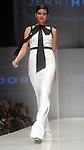 A model walks the runway wearing Jerri Moore at the first night of Fashion Houston at the Wortham Theater Monday Oct. 10,2011.(Dave Rossman/For the Chronicle)