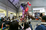 Visitors take pictures of a giant from Attack on Titan manga series during the AnimeJapan 2017 at Tokyo Big Sight on March 25, 2017, Tokyo, Japan. AnimeJapan 2017 is a trade show promoting ''Everything Anime'' to local and foreign fans and businesses. The show is held over four-day days with March 23-24 reserved for business visitors and March 25-26 for the public. It is expected to attract some 120,000 visitors, including cosplayers. (Photo by Rodrigo Reyes Marin/AFLO)