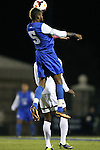 25 October 2013: Duke's Sebastien Ibeagha (5) heads the ball. The Duke University Blue Devils hosted the Wake Forest University Demon Deacons at Koskinen Stadium in Durham, NC in a 2013 NCAA Division I Men's Soccer match. The game ended in a 2-2 tie after two overtimes.