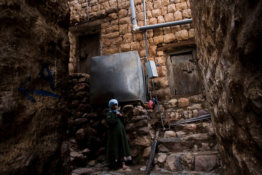 Yemen - Al Tawilah - Little girl standing in the street next to a water tank. Yemen's economy depends heavily on oil production, and its government receives the vast majority of its revenue from oil taxes. Yet analysts predict that the country's petroleum output, which has declined over the last seven years, will fall to zero by 2017. The government has done little to plan for its post-oil future. Yemen's population, already the poorest on the Arabian peninsula and with an unemployment rate of 35%, is expected to double by 2035..The trends will exacerbate large and growing environmental problems, including the exhaustion of Yemen's groundwater resources. Given that a full 90% of the country's water is used for agriculture, this trend portends disaster..Sanaa's well are expected to dry out by 2015, partly due to illegal drilling, partly because 40% of the city's water is diverted for qat production, and partly because conservation rules are difficult to enforce. Only 20% of the houses receive water, the other 80% has to collect it from pumps and wells. 15% of the urban population only uses bottled water as its primary drinking water source and that is why Yemen has one of the highest world mortality rate, most of the diseases being related to water..