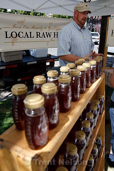 Salt Lake City - Lee Knight of Knight Family Honey (Lehi) with his product at a new harvest market, which goes from 4 to 7 p.m., which begins today Tuesday August 4, 2009. It's a farmers market that focuses on food vendors only, not the craftspeople and others who sell at the Saturday farmers market. It continues through the summer.