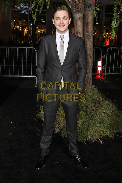 """Kyle Gallner.""""Beautiful Creatures"""" Los Angeles Premiere held at the TCL Chinese Theatre, Hollywood, California, USA. .February 6th, 2013.full length grey gray suit white shirt tie hands in pockets .CAP/CEL .©CelPh/Capital Pictures."""