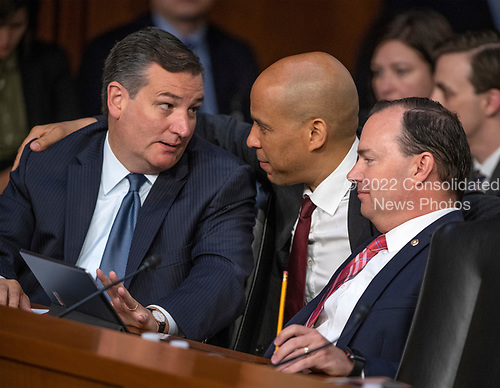 United States Senators Ted Cruz (Republican of Texas), left, Cory Booker (Democrat of New Jersey), center, and Mike Lee (Republican of Utah) converse during the hearing on the nomination of Judge Brett Kavanaugh before the US Senate Judiciary Committee on his nomination as Associate Justice of the US Supreme Court to replace the retiring Justice Anthony Kennedy on Capitol Hill in Washington, DC on Friday, September 7, 2018.<br /> Credit: Ron Sachs / CNP